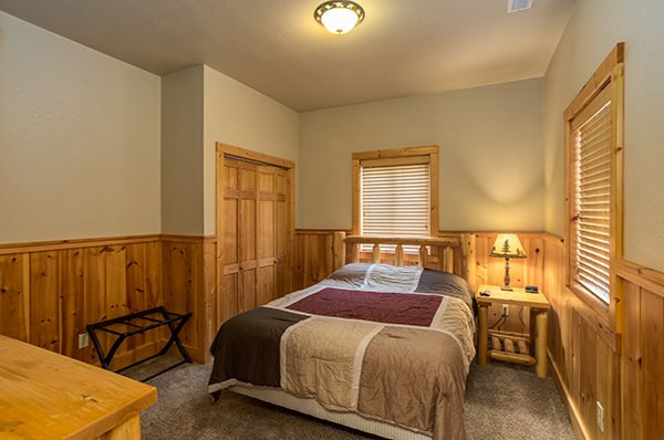Log queen-sized bed in the first floor bedroom at A Great Escape, a 4-bedroom cabin rental located in Pigeon Forge