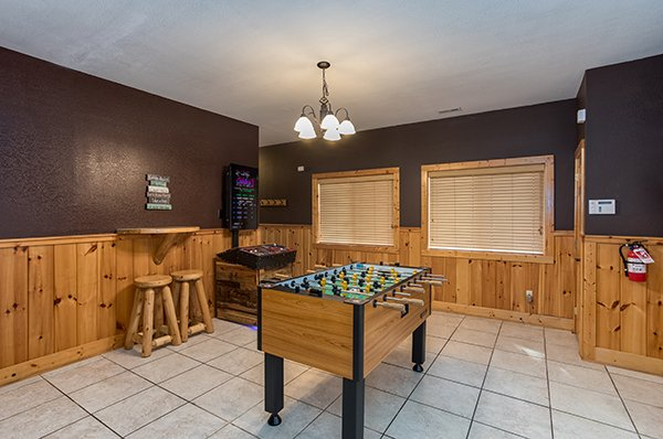 Foosball table in the game room A Great Escape, a 4-bedroom cabin rental located in Pigeon Forge
