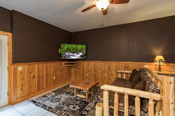 Television in the game room A Great Escape, a 4-bedroom cabin rental located in Pigeon Forge