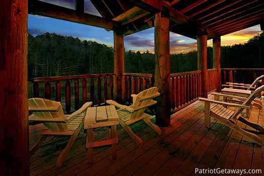 Night skies surround you on the deck at A Great Escape, a 4-bedroom cabin rental located in Pigeon Forge