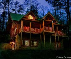 Front exterior at night of Corthouse, a 4-bedroom cabin rental located in Pigeon Forge