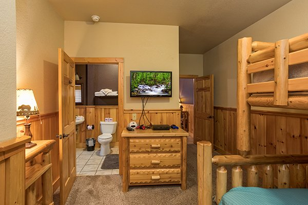 TV and game system in the bunk bedroom with an en suite Corthouse, a 4-bedroom cabin rental located in Pigeon Forge