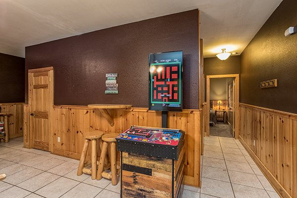 Arcade game in the game room Corthouse, a 4-bedroom cabin rental located in Pigeon Forge