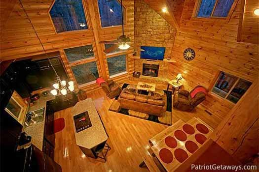 view down from the lofted bedroom at corthouse a 4 bedroom cabin rental located in pigeon forge