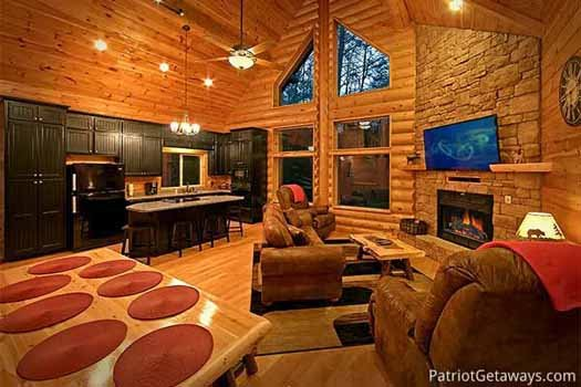 View of the kitchen and living room at Corthouse, a 4-bedroom cabin rental located in Pigeon Forge