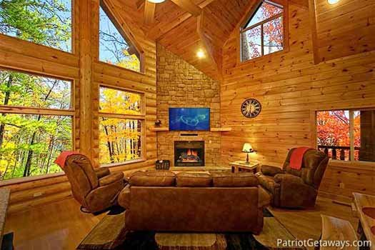 Stone fireplace in the corner of the living room at Corthouse, a 4-bedroom cabin rental located in Pigeon Forge