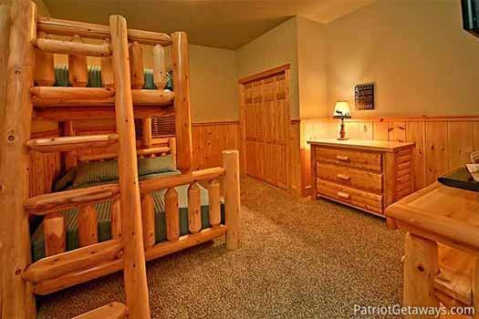 twin sized bunk of full sized bed in bedroom at corthouse a 4 bedroom cabin rental located in pigeon forge