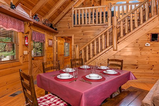 Dining table with seating for six at Lazy Bear Lodge, a 2 bedroom cabin rental located in Pigeon Forge