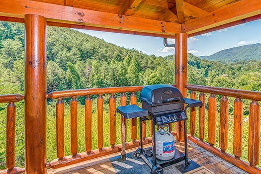 Gas grill on a covered deck with mountain views at Lazy Bear Lodge, a 2 bedroom cabin rental located in Pigeon Forge