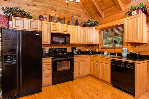 Kitchen with black appliances at Lazy Bear Lodge, a 2 bedroom cabin rental located in Pigeon Forge