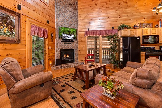 Living room and kitchen on the open concept main floor at Lazy Bear Lodge, a 2 bedroom cabin rental located in Pigeon Forge
