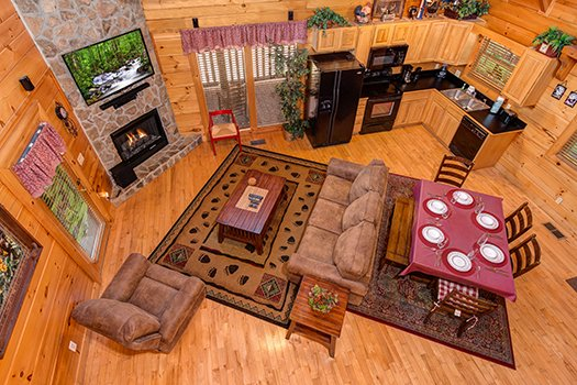 Looking down on the open concept main floor from the upper floor at Lazy Bear Lodge, a 2 bedroom cabin rental located in Pigeon Forge