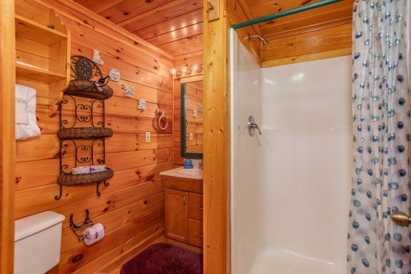 Bathroom with a walk in shower at All Shook Up, a 1 bedroom cabin rental located in Pigeon Forge
