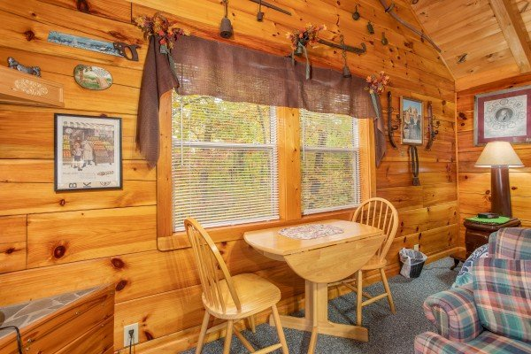 Dining table for two at All Shook Up, a 1 bedroom cabin rental located in Pigeon Forge