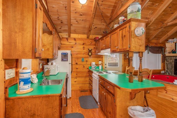 Galley kitchen at All Shook Up, a 1 bedroom cabin rental located in Pigeon Forge