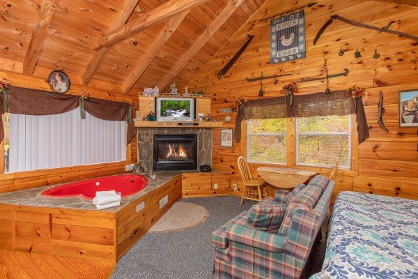 Studio cabin with jacuzzi and fireplace at All Shook Up, a 1 bedroom cabin rental located in Pigeon Forge