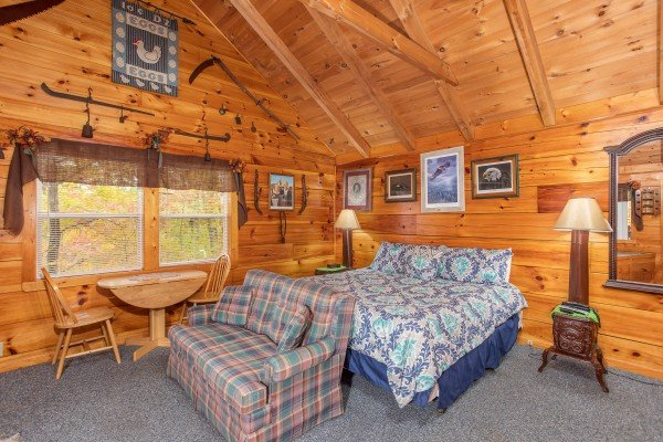 Studio concept with dining space bed and love seat at All Shook Up, a 1 bedroom cabin rental located in Pigeon Forge