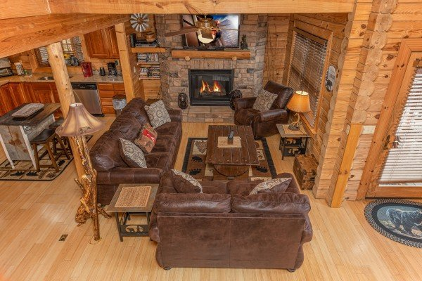 Living room with sofa, loveseat, and chair, fireplace and TV at Heavenly Homestead, a 4 bedroom cabin rental located in Pigeon Forge