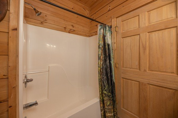 Tub and shower at Heavenly Homestead, a 4 bedroom cabin rental located in Pigeon Forge