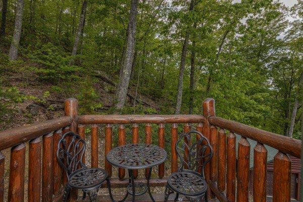Bistro set on the deck at Heavenly Homestead, a 4 bedroom cabin rental located in Pigeon Forge