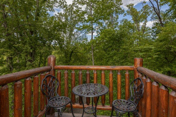 Bistro set on a deck at Heavenly Homestead, a 4 bedroom cabin rental located in Pigeon Forge