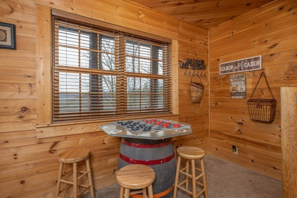 Checker game on a barrel table at Heavenly Homestead, a 4 bedroom cabin rental located in Pigeon Forge