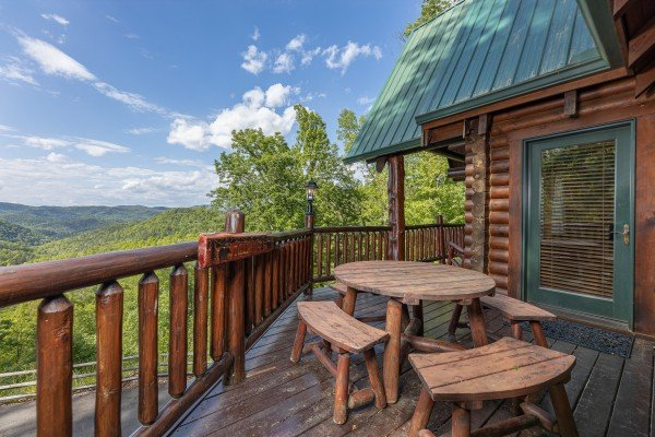 Deck dining for four at Heavenly Homestead, a 4 bedroom cabin rental located in Pigeon Forge