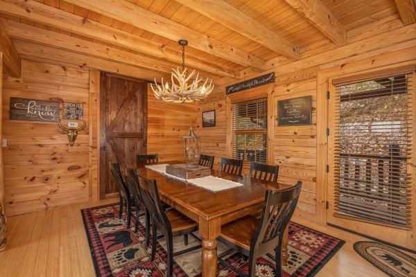 Dining room with seating for 8 at Heavenly Homestead, a 4 bedroom cabin rental located in Pigeon Forge