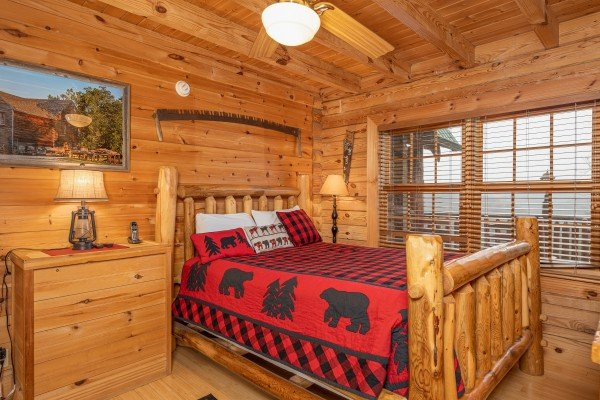 Bedroom with log bed, dresser, and lamps at Heavenly Homestead, a 4 bedroom cabin rental located in Pigeon Forge