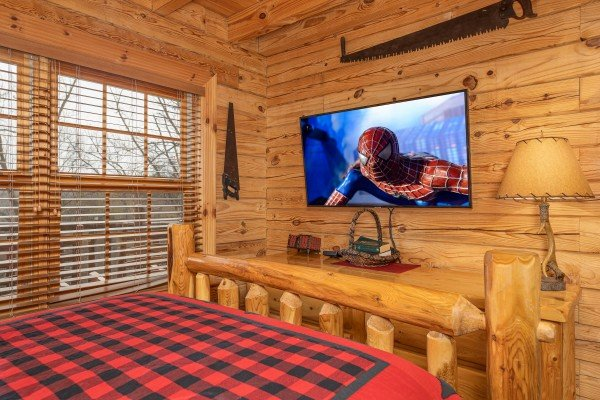 TV and dresser in a bedroom at Heavenly Homestead, a 4 bedroom cabin rental located in Pigeon Forge