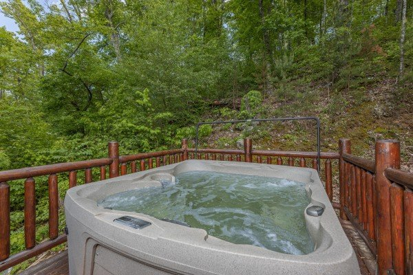 Hot tub on a deck at Heavenly Homestead, a 4 bedroom cabin rental located in Pigeon Forge