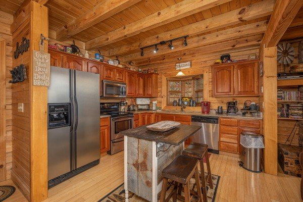 Kitchen with stainless appliances and breakfast bar at Heavenly Homestead, a 4 bedroom cabin rental located in Pigeon Forge