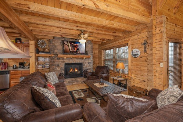 Living room with fireplace and TV at Heavenly Homestead, a 4 bedroom cabin rental located in Pigeon Forge