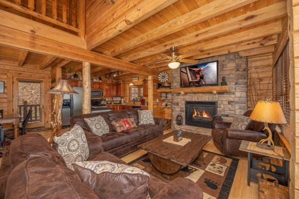 Plenty of seating, a fireplace, and TV in the living room at Heavenly Homestead, a 4 bedroom cabin rental located in Pigeon Forge
