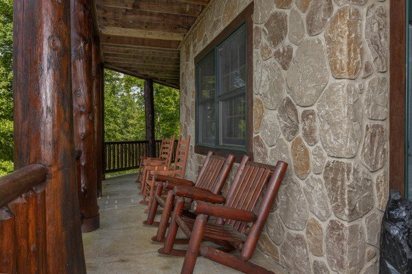 Rocking chairs on the lower deck at Heavenly Homestead, a 4 bedroom cabin rental located in Pigeon Forge