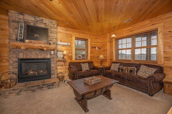 Fireplace, sofa and loveseat at Heavenly Homestead, a 4 bedroom cabin rental located in Pigeon Forge