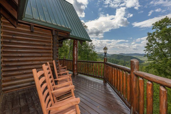 Rocking chairs on a deck at Heavenly Homestead, a 4 bedroom cabin rental located in Pigeon Forge