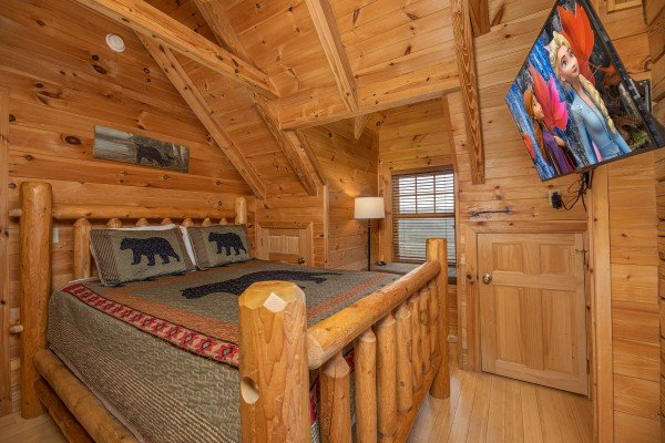 Bedroom with log bed and TV at Heavenly Homestead, a 4 bedroom cabin rental located in Pigeon Forge