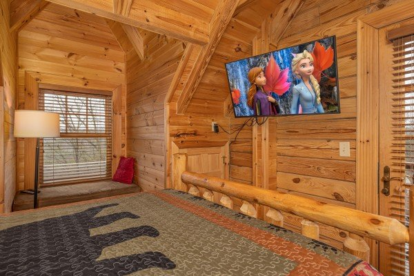 TV in a bedroom at Heavenly Homestead, a 4 bedroom cabin rental located in Pigeon Forge