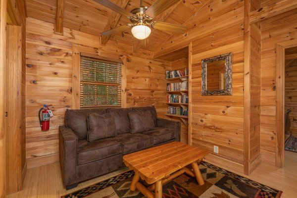 Sleeper sofa at Heavenly Homestead, a 4 bedroom cabin rental located in Pigeon Forge