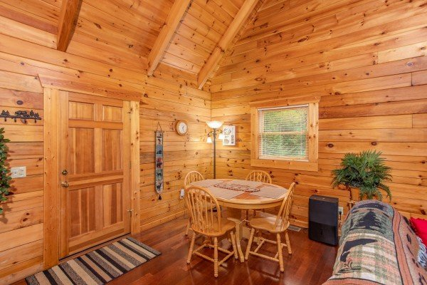 Dining space with seating for four at Enchanted Evening, a 1-bedroom cabin rental located in Pigeon Forge