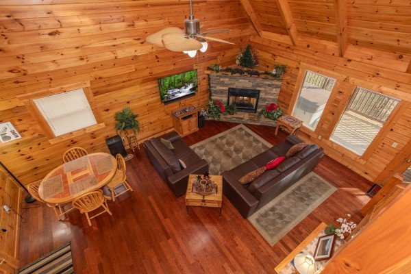 Looking down into the living room from the upper floor at Enchanted Evening, a 1 bedroom Pigeon Forge cabin rental