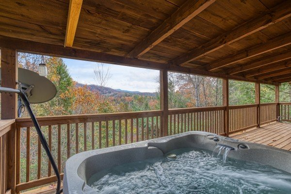 Views of the Smoky Mountains from the hot tub on the covered deck at Enchanted Evening, a 1-bedroom cabin rental located in Pigeon Forge