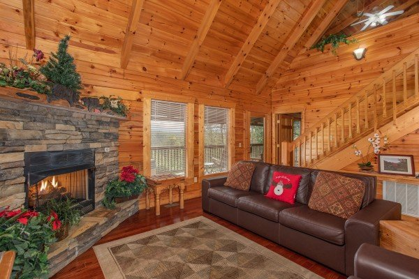 Fireplace and sofa in the vaulted living room at Enchanted Evening, a 1 bedroom Pigeon Forge cabin rental