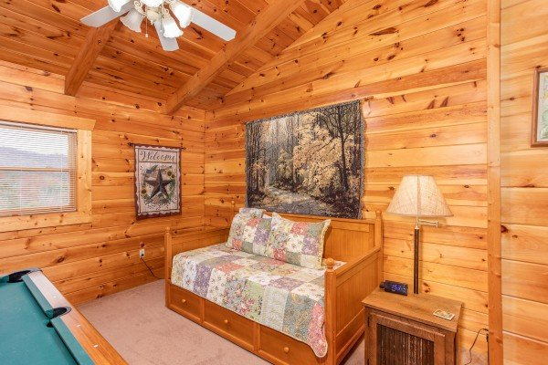 Trundle bed in the loft space at Enchanted Evening, a 1-bedroom cabin rental located in Pigeon Forge