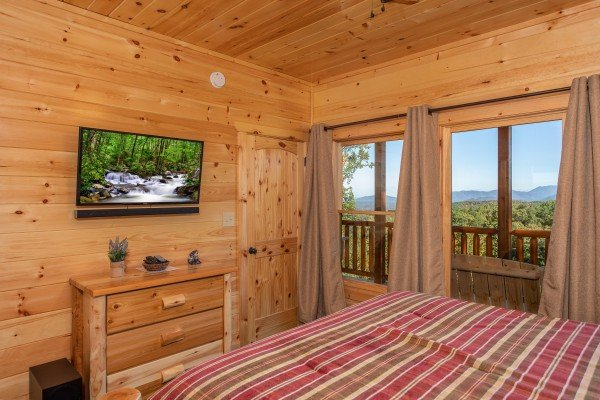 Dresser and TV in a bedroom at Panorama, a 2 bedroom cabin rental located in Pigeon Forge