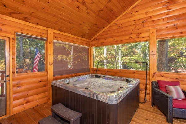 Hot tub on a screened in porch at Panorama, a 2 bedroom cabin rental located in Pigeon Forge
