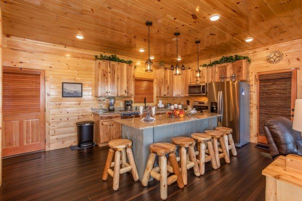 Kitchen with island seating for six at Panorama, a 2 bedroom cabin rental located in Pigeon Forge