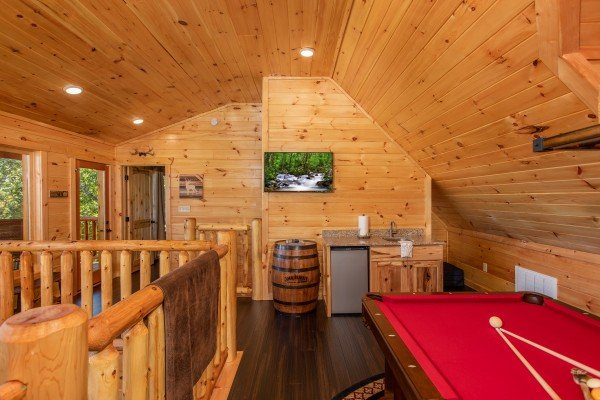 Mini wet bar, TV, and pool table in the loft at Panorama, a 2 bedroom cabin rental located in Pigeon Forge