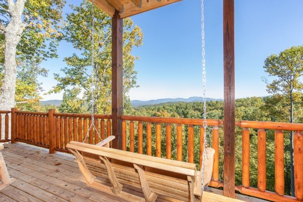 Porch swing facing the mountain view at Panorama, a 2 bedroom cabin rental located in Pigeon Forge